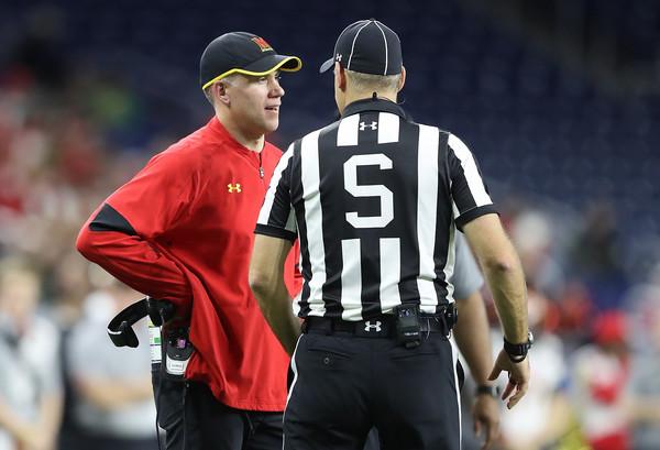 Maryland Terrapins hews football coach D.J. Durkin talks to an official during a bowl game
