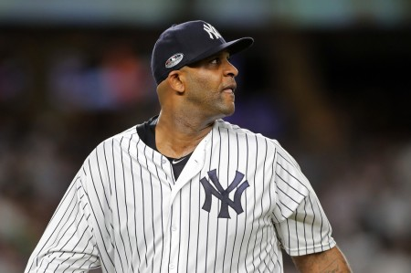 New York Yankees pitcher C.C. Sabathia walking to the dug out after giving up three runs