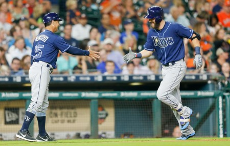 Tampa Bay Rays third base coach Charlie Montoyo gets ready to shake hands with Steven Souza Jr. after a home run