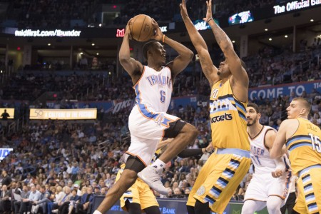 Denver Nuggets' Darrell Arthur playing defense against Semaj Christon as he drives to the basket