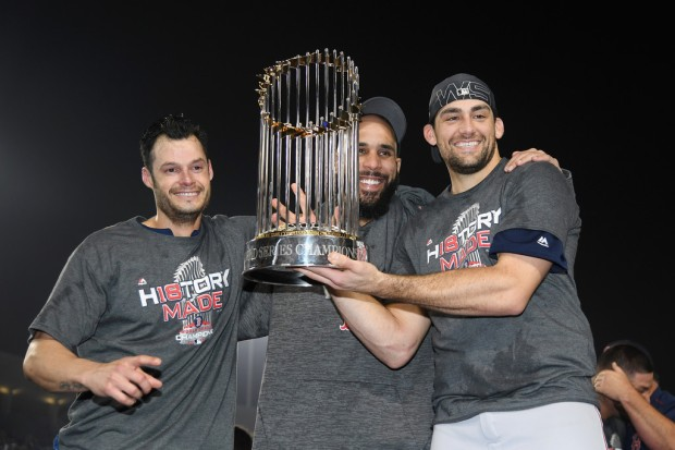Boston Red Sox pitchers David Price, Nathan Eovaldi, and Joe Kelly with the World Series Trophy