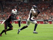 Then-Denver Broncos wide receiver Demaryius Thomas makes a catch against the Arizona Cardinals