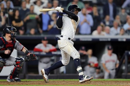 New York Yankees shortstop Didi Gregorius hits a single in the ninth inning of Game Four of the ALDS against the Boston Red Sox