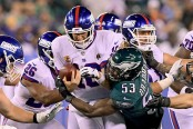 New York Giants quarterback Eli Manning being sacked by Philadelphia Eagles linebacker Nigel Bradham