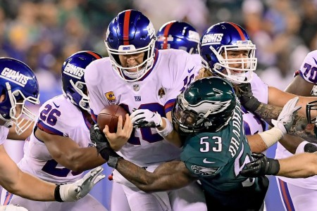 New York Giants quarterback Eli Manning being sacked by Philadelphia Eagles linebacker Nigel Bradham