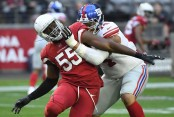 Former New York Giants offensive lineman Ereck Flowers blocks Arizona Cardinals outside linebacker Chandler Jones