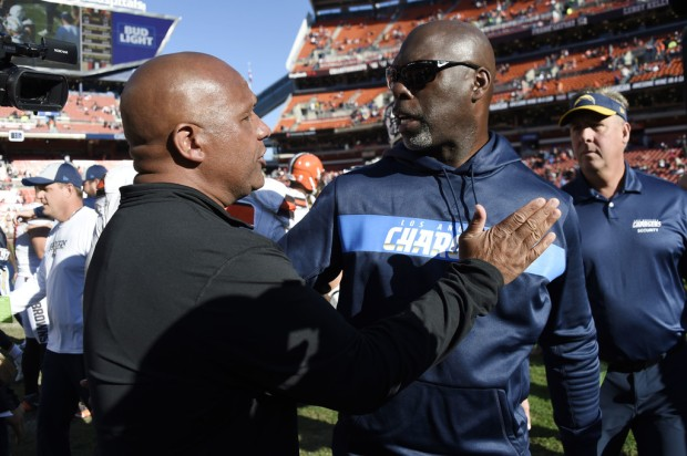 Cleveland Browns head coach Hue Jackson talking to Los Angeles Chargers head coach Anthony Lynn after the game