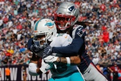 New England Patriots cornerback Stephon Gilmore making a tackle on Miami Dolphins' Albert Wilson