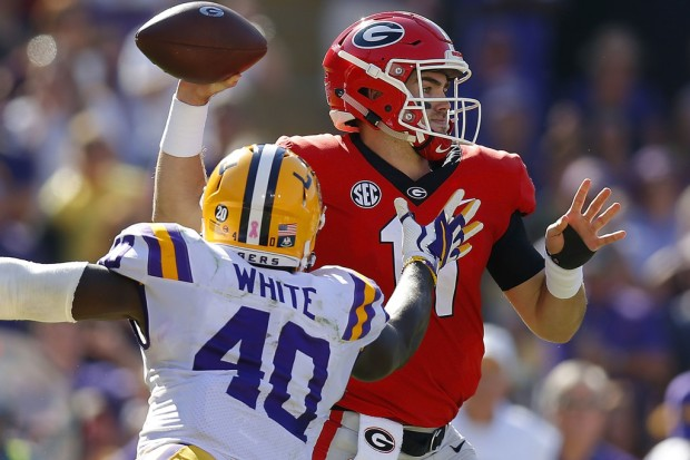 Georgia Bulldogs quarterback Jake Fromm attempting a pass against the LSU Tigers