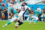 Former Denver Broncos running back Jamaal Charles running the ball against the Miami Dolphins