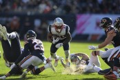 New England Patriots running back James White carries the ball against the Chicago Bears