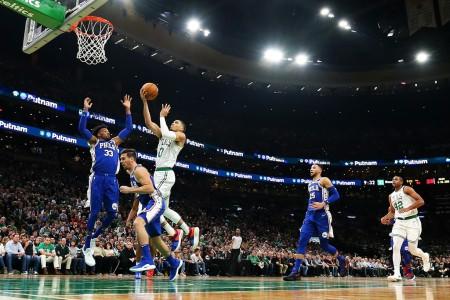Boston Celtics star Jayson Tatum going up for a layup against the Philadelphia 76ers