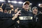 Purdue Boilermakers head coach Jeff Brohm is mobbed by fans after his team defeated No. 2 Ohio State Buckeyes