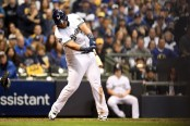 Milwaukee Brewers first baseman Jesús Aguilar hitting an RBI single against the Los Angeles Dodgers