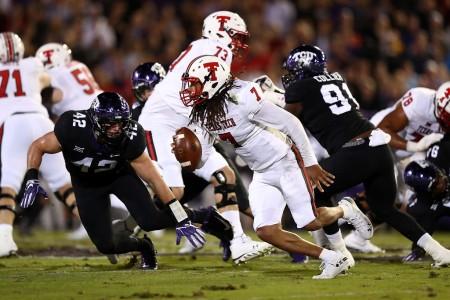 Texas Tech quarterback Jett Duffey running the ball against the TCU Horned Frogs