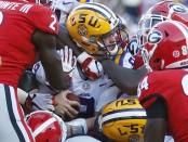 LSU Tigers quarterback Joe Burrow scores a touchdown against the Georgia Bulldogs