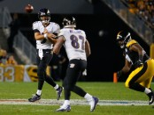 Baltimore Ravens quarterback Joe Flacco attempts a pass to tight end Maxx Williams