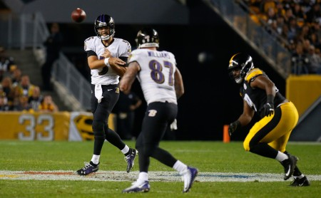 Baltimore Ravens quarterback Joe Flacco attempts a pass to tight end Maxx Williams