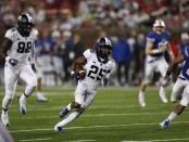 TCU Horned Frogs wide receiver and kick returner KaVontae Turpin runs for a touchdown against the SMU Mustangs