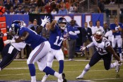 New York Giants rookie quarterback Kyle Lauletta passing against the New England Patriots in the preseason