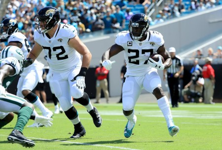 Jacksonville Jaguars running back Leonard Fournette rushing the ball against the New York Jets