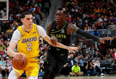 Los Angeles Lakers guard Lonzo Ball driving to the basket while being guarded by former Atlanta Hawks guard Dennis Schröder
