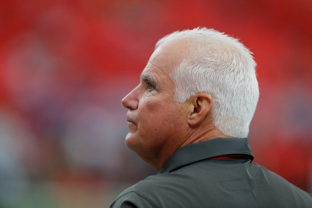 Tampa Bay Buccaneers defensive coordinator Mike Smith standing on the field before pregame warmups