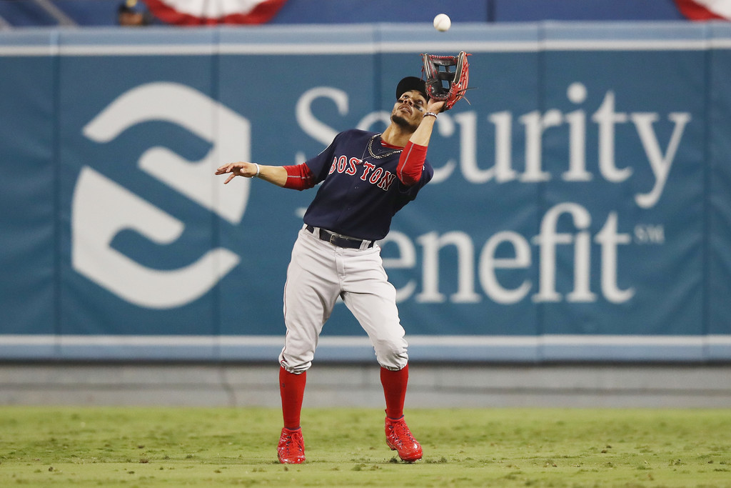 Boston Red Sox outfielder Mookie Betts catches an out against the Los Angeles Dodgers in the World Series