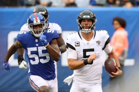 Then-New York Giants linebacker Ray-Ray Armstrong attempting to tackle Jacksonville Jaguars quarterback Blake Bortles
