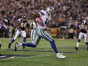 Dallas Cowboys wide receiver Roy Williams catches a touchdown pass against the Minnesota Vikings