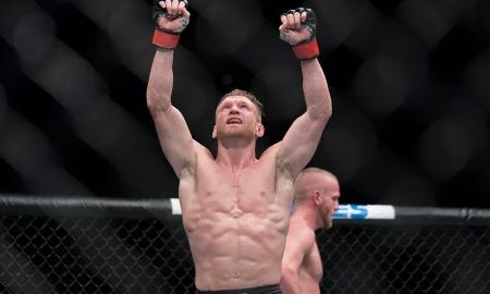 MMA fighter Scott Holtzman raising his hands after fighting Darrell Horcher