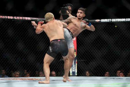MMA fighter Sergio Pettis kicking Joseph Benavidez in the first-round at UFC 225