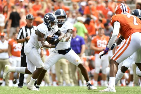 Georgia Southern quarterback Shai Werts handing the ball off to running back Wesley Fields against the Clemson Tigers