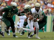 Georgia Tech Yellow Jackets quarterback Tobias Oliver rushes the ball against the South Florida Bulls