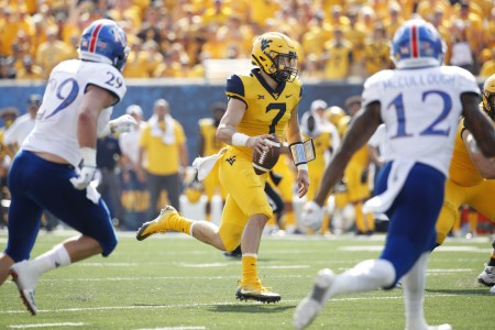 West Virginia Mountaineers quarterback Will Grier running the ball against the Kansas Jayhawks