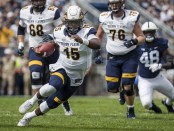 Kent State Golden Flashes quarterback Woody Barrett scrambled against the Penn State Nittany Lions