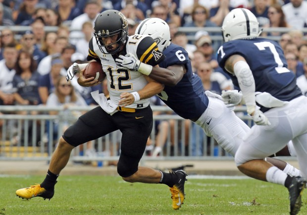 Appalachian State Mountaineers quarterback Zac Thomas running the ball against the Penn State Nittany Lions