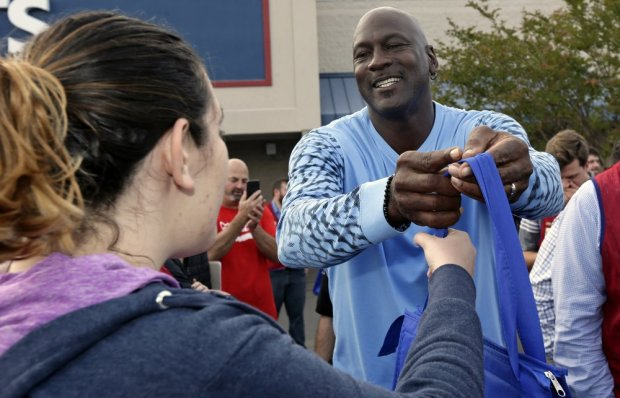 Charlotte Hornets owner Michael Jordan hands out food for Thanksgiving to Wilmington, North Carolina residents