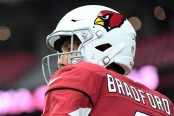 Former Arizona Cardinals quarterback Sam Bradford warming up against the Chicago Bears