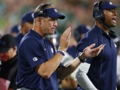 Former Utah State Aggies head coach Matt Wells looks on against the Michigan State Spartans