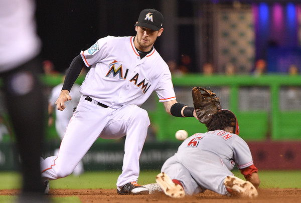 Cincinnati Reds outfielder Billy Hamilton attempting to steal a base against the Miami Marlins