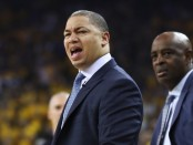 Former Cleveland Cavaliers head coach Tyronn Lue and interim head coach Larry Drew look on during the 2018 NBA Finals