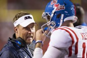 Former Ole Miss Rebels head coach Hugh Freeze talking to Chad Kelly against the Arkansas Razorbacks