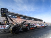 Great Clips/Parts Plus Top Fuel Dragster pilot Clay Millican racing on Saturday at the NHRA Toyota Nationals