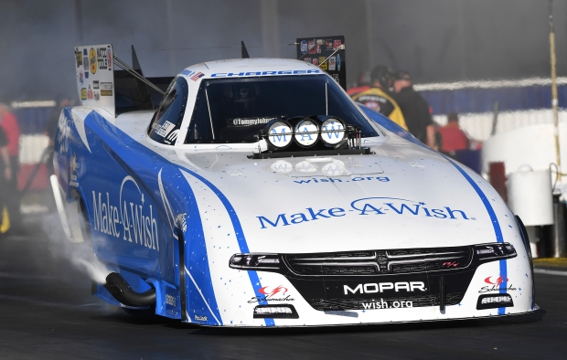 Make-A-Wish Foundation Funny Car pilot Tommy Johnson Jr. racing on Friday at the Auto Club NHRA Nationals