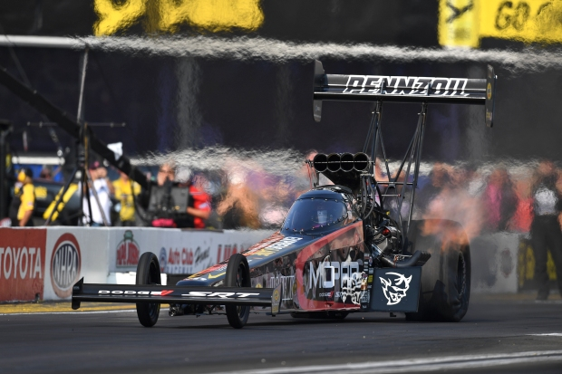 Dodge Mopar Top Fuel Dragster Leah Pritchett racing on Saturday at the Auto Club NHRA Nationals