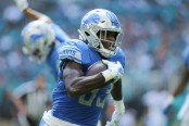 Detroit Lions running back Kerryon Johnson rushing the ball against the Miami Dolphins