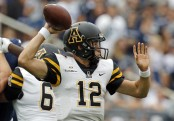 Appalachian State Mountaineers quarterback Zac Thomas attempting a pass against the Penn State Nittany Lions