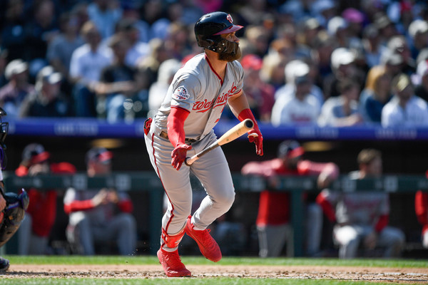 Former Washington Nationals star Bryce Harper gets a hit against the Colorado Rockies