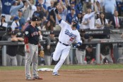 Los Angeles Dodgers David Freese celebrates a home run against the Boston Red Sox in the World Series